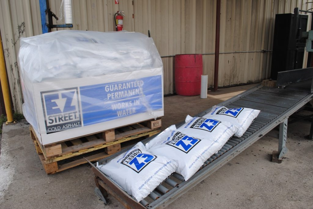 Newly bagged packages of EZ Street asphalt are prepared for delivery.