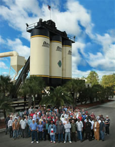 Duval Asphalt employees gather in front of their asphalt plant.