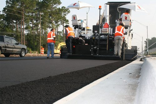 Workers paving a road