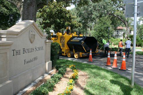 Workers resurfacing damaged pavement