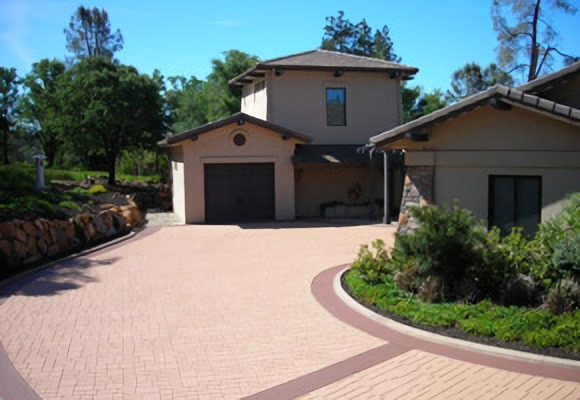 A residential driveway with decorative asphalt