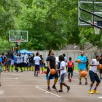 grand opening celebration of kids playing on new basketball court