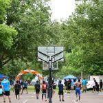 grand opening celebration of kids playing basketball on new court