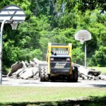 The old basketball court is torn up from the ground