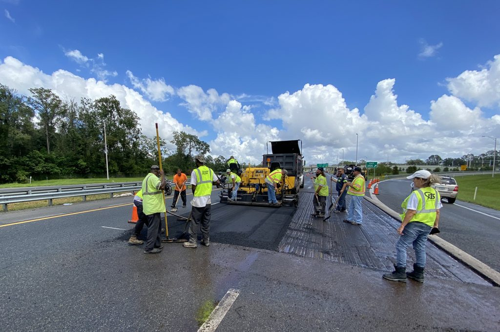 Photo of Duval Asphalt paving crew paving emergency repair on I-10 eastbound, just west of the Hammond Blvd. exit.