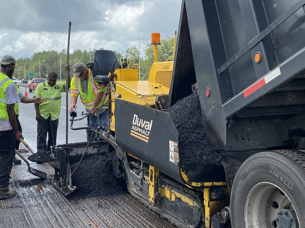 Close up image of Duval Asphalt paver on I-10 emergency repair